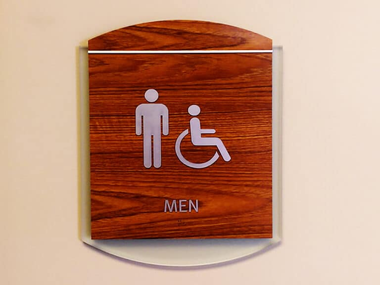 layered mens room sign